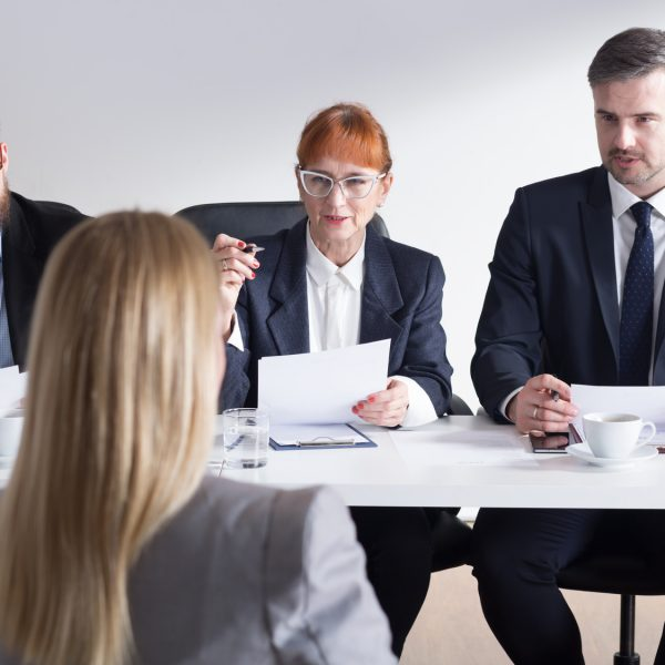 Shot of recruiters talking with a job applicant
