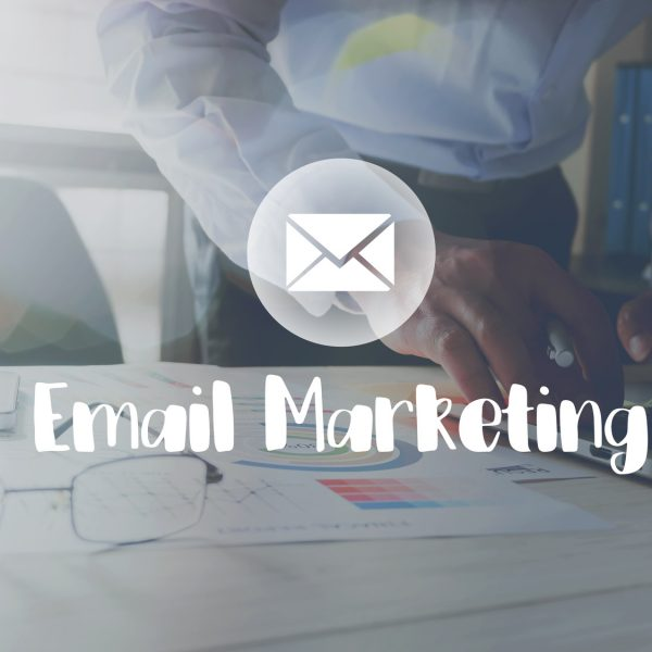 Email Marketing message on the working in the office on table background.