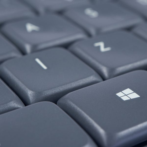 Windows button on grey keyboard with focus and soft focused background